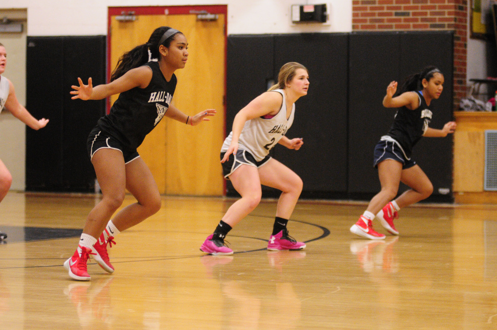 Thea Sweet, left, Emma Begin, center, and Dani Sweet run drills Tuesday at Penny Memorial Gym in Farmingdale.