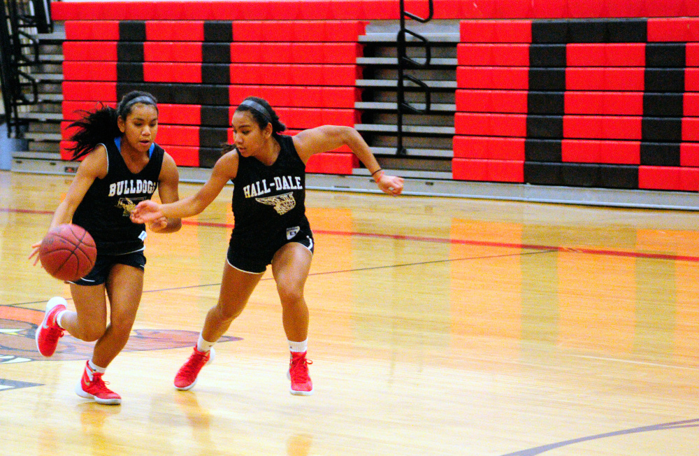 Dani Sweet, left, tries to get past sister Thea during practice Tuesday at Hall-Dale's Penny Memorial Gym in Farmingdale.