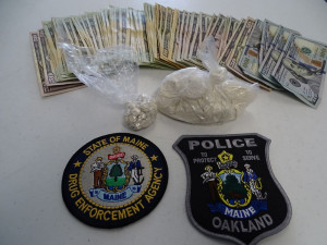 Heroin and money the Maine Drug Enforcement Agency says it seized during a Thursday morning bust in Oakland.