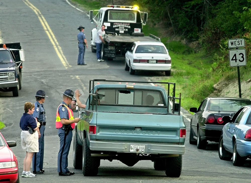 State police operate a roadblock near the entrance to Hempstock, a marijuana festival, in Starks in 2002. The town, with a long history of divided opinion concerning marijuana issues, is considering a temporary moratorium on medical marijuana businesses until officials can determine what kind of regulations may be needed.