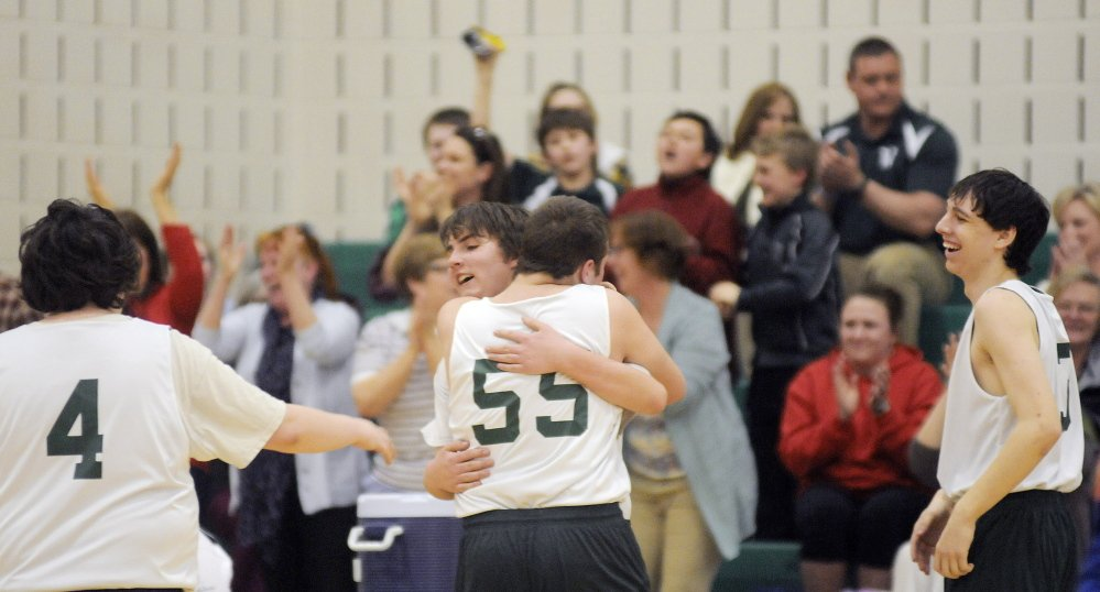 Sebastian Coston, right, hugs Winthrop Unified teammate Sage Thomas after Thomas drained a 3-pointer that drove fans and teammates to their feet during a quarterfinal last season in Winthrop.