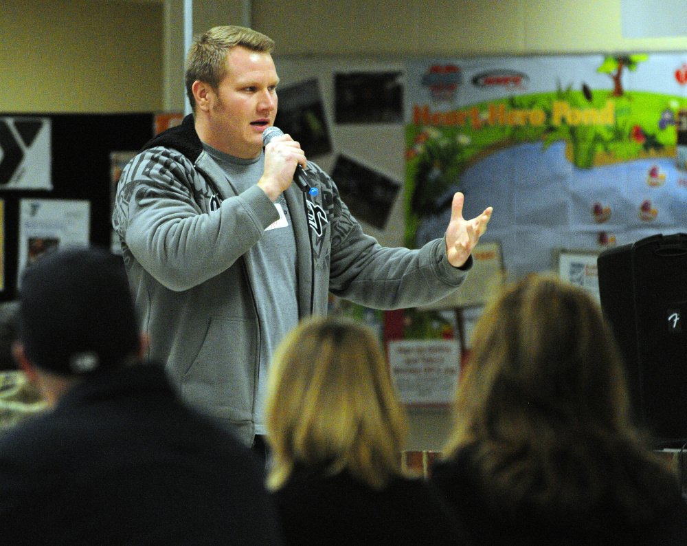 Andrew Kiezulas, from the Young People in Recovery group, gives opening remarks Thursday during the Opiates in Gardiner event at Gardiner Regional Middle School.