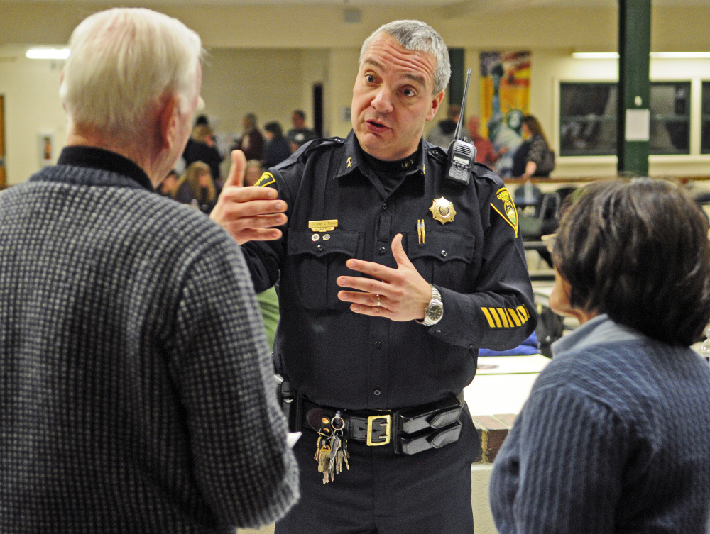 Gardiner police Chief Jim Toman talks to people visiting the intervention information tables Thursday during the Opiates in Gardiner event at Gardiner Regional Middle School.
