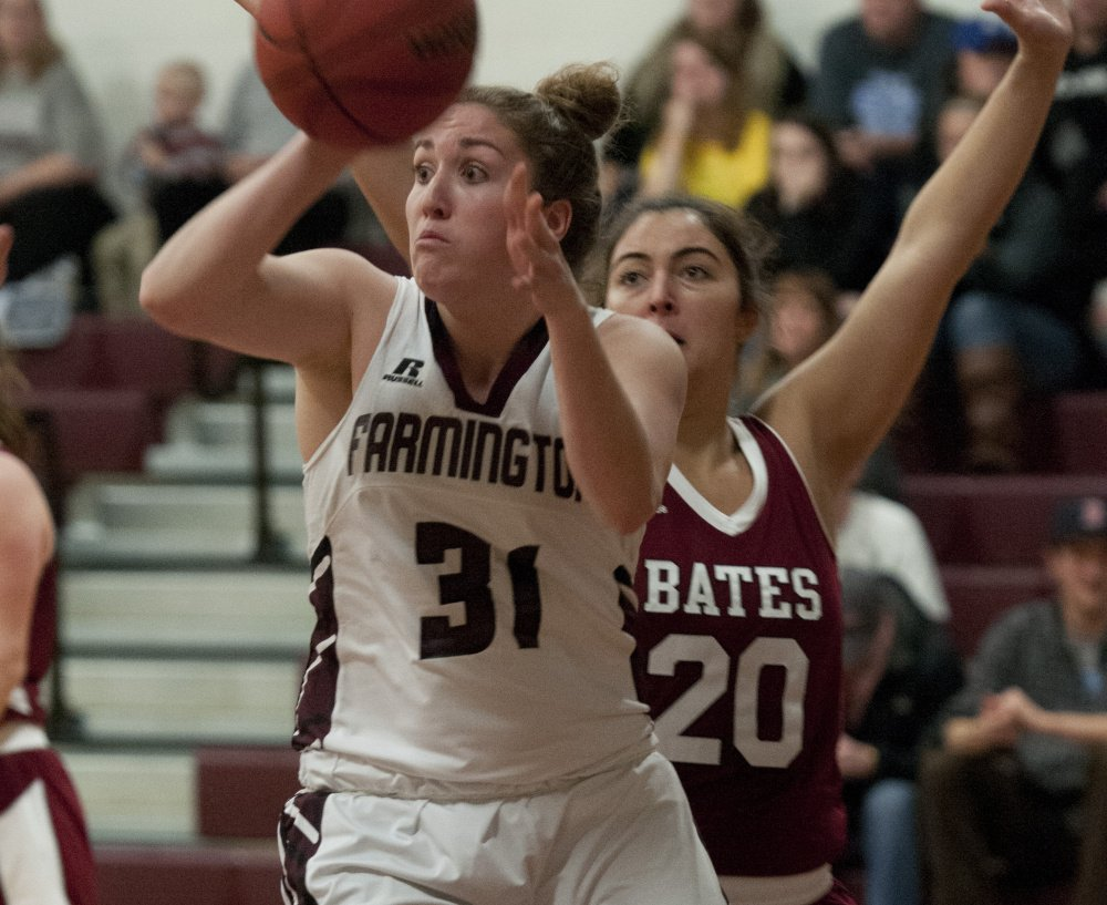 Contributed photo University of Maine-Farmington senior Meghan Smith passes the ball in a game against Bates last season. Smith, a Boothbay graduate, is averaging 15.6 points and 10.9 rebounds per game for the Beavers this season.
