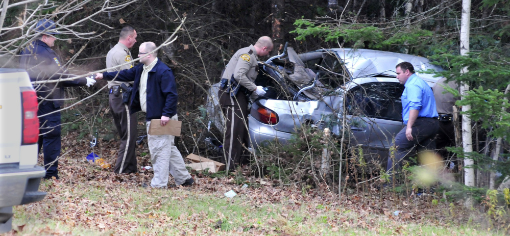 Somerset, state and Skowhegan police remove evidence from the wreckage of the car that Robert Tucker was driving during a police chase that started in Skowhegan and ended when the car left the Huff Road in Cornville and crashed into trees on Nov. 2. Tucker was indicted by a Somerset County grand jury on a number of charges this week.