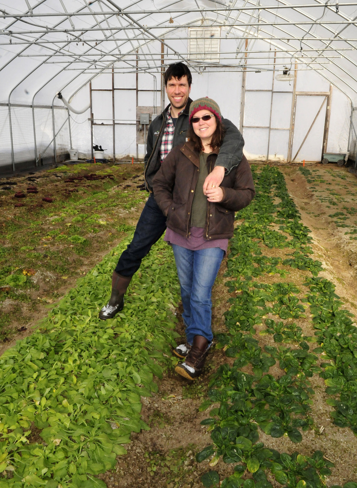 "Cornville farmers Andrew and Ann Mefferd inside one of four greenhouses at their One Drop Farm on Wednesday. The Mefferds now also own ""Growing for Market"" magazine."