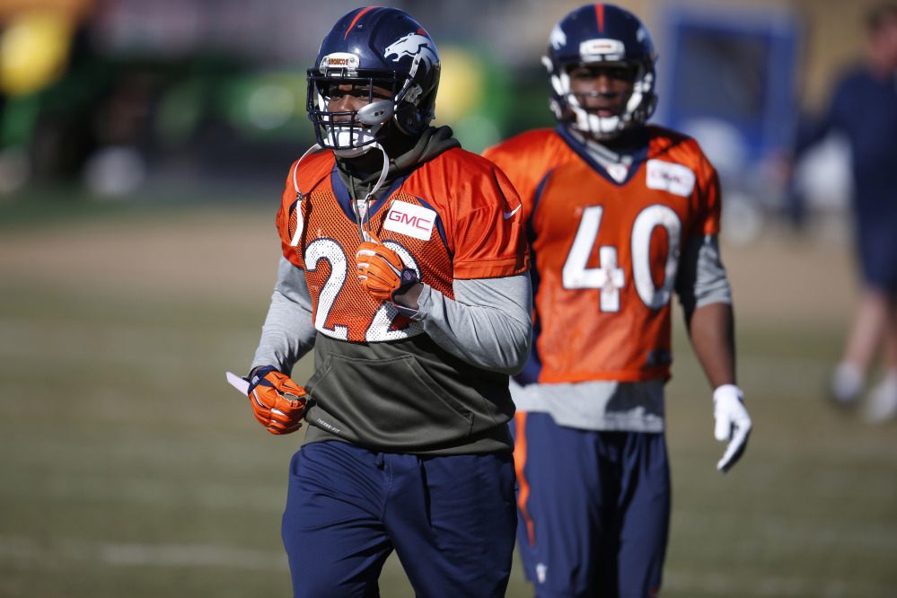 AP photo   Denver Broncos running back C.J. Anderson, front, takes part in a drill with runningback Juwan Thompson during practice at the team's headquarters Thursday in Englewood, Colorado.