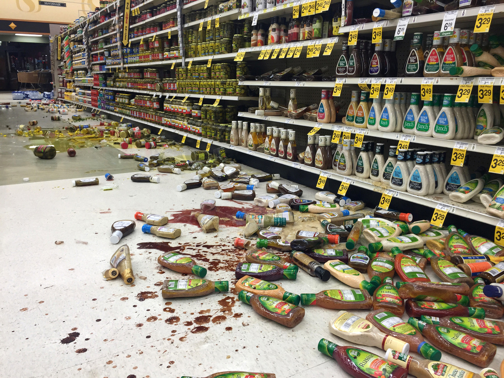 In this photo provided by Vincent Nusunginya, items fallen from the shelves litter the aisles inside a Safeway grocery store following a magnitude 6.8 earthquake on the Kenai Peninsula on Sunday in south-central Alaska.