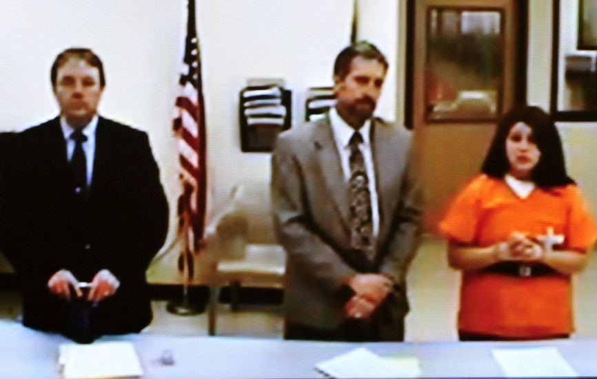 Defendant Kayla Stewart appeared in a video during a hearing at the Skowhegan District Court on a charge of murder in connection with the death of her newborn son found by police at her home in Fairfield. Next to Stewart is her attorney, Phillip Mohlar, and at left is state attorney Brent Davis.