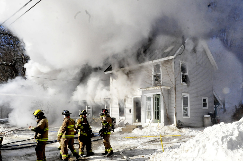 Firefighters from multiple departments battle a smokey fire that destroyed a home on Water Street in Oakland on Jan. 8. The fire department is trying to get households to recognize the importance if smoke detectors and is offering free detectors for residents without them.