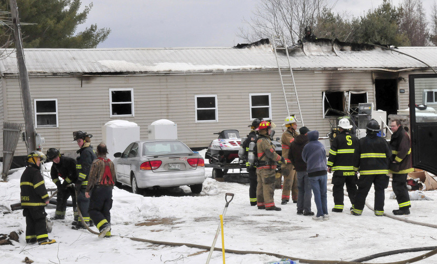 Firefighters from several departments battled a fire that destroyed a mobile home on South Main Street in Athens Tuesday morning,