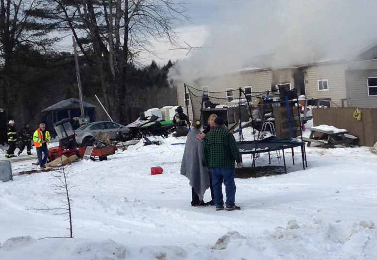 A mobile home fire on South Main Street in Athens Tuesday morning sent one woman to the hospital with burns.