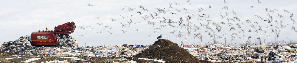 A Riverside Disposal truck dumps a load Tuesday at Hatch Hill Landfill in Augusta.