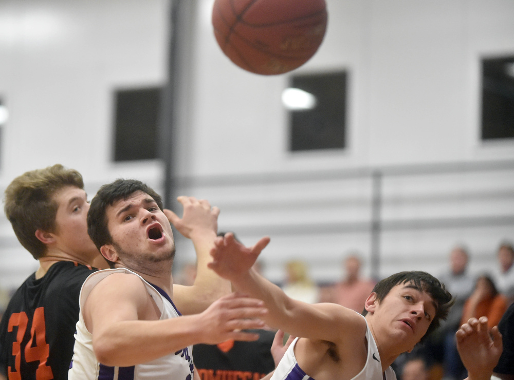 Waterville's Justin Kornsey, center, and Michael Nigro, right, look to grab a rebound as Skowhegan's Garrett McSweeney closes in on the play during a Kennebec Valley Athletic Conference Class A game Tuesday night in Waterville.