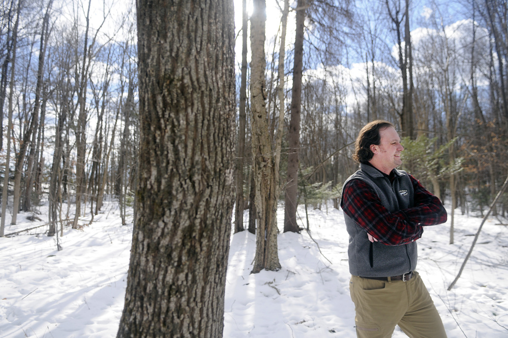 Kennebec Land Trust stewardship director Jean-Luc Theriault walks Wednesday the new 72 acre parcel in Winthrop the non-profit recently acquired in the Mount Pisgah conservancy.