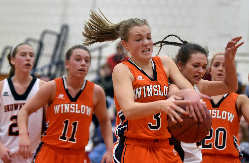 Winslow High School's Paige Trask (3) battles for the rebound with Skowhegan Area High School's Alyssa Cobb during a Jan. 15 game.