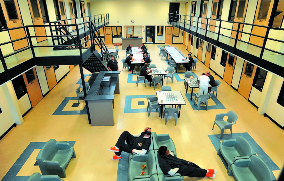 Inmates read and play board games in the day room in the medium security wing at the Somerset County Jail in East Madison in 2014. A suit brought by the girlfriend of an inmate who died at the jail that year, Joseph Dauost, is being settled for nearly $2 million.