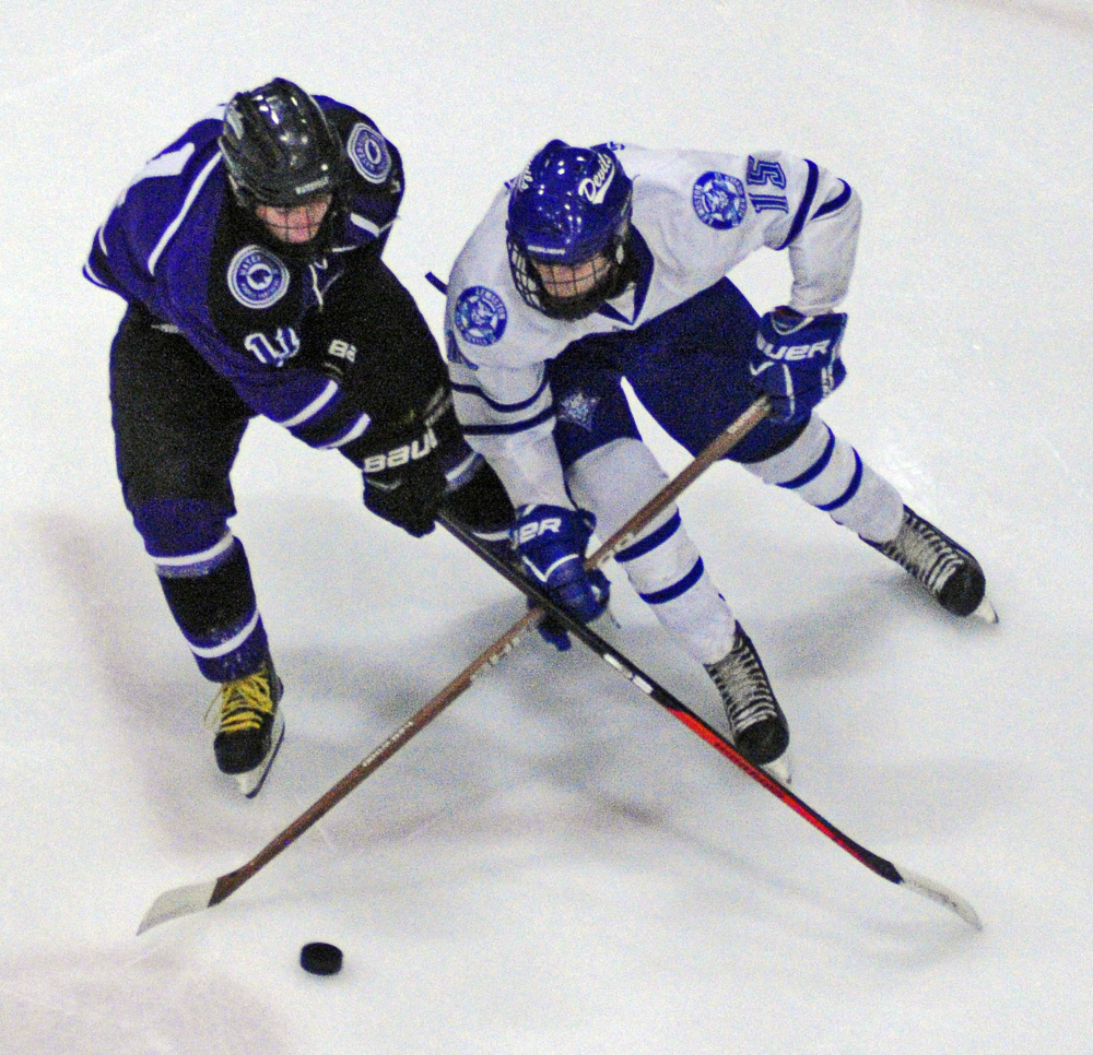 Waterville's Jackson Aldrich, left, and Lewiston's Jean-Luc Dostie battle for control of the puck during a game Wednesday at Androscoggin Bank Colisée in Lewiston.