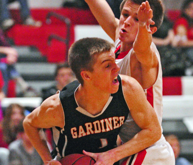 Gardiner's Eli Fish, left, looks for a teammate to pass to as Cony's Nate Parlin plays tight defense earlier this season at Cony High in Augusta.