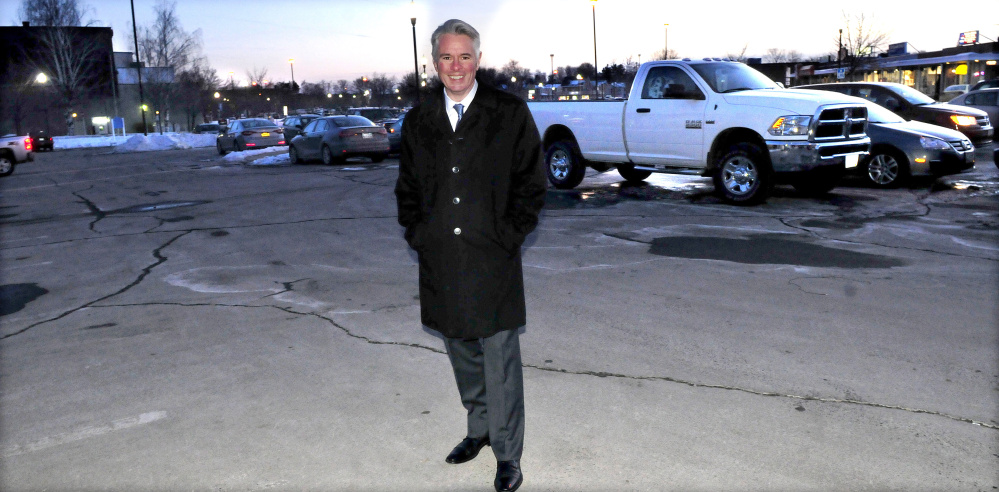 Colby College President David Greene stands inside the Concourse parking lot in Waterville Monday, which the college hopes to buy from the city for $300,000. If the City Council agrees to the sale, the college would build a dormitory with first-floor commercial space, which would be owned by someone other than the college.
