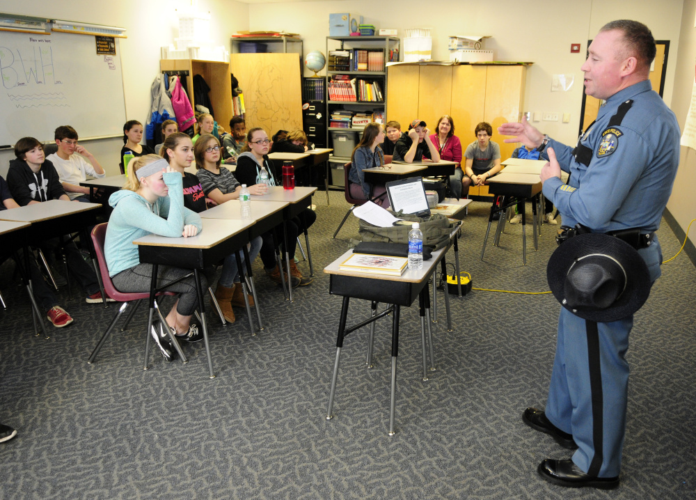 Maine State Police Trooper Bernard Campbell talks to students during Healthy Decisions Day events on Friday at Maranacook Community Middle School in Readfield.