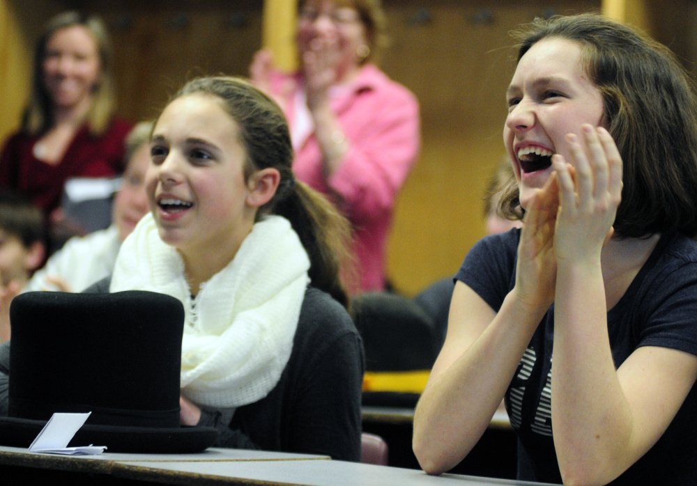 Caroline Welch, left, and Dana Reynolds clap during Randy Judkins' presentation during Healthy Decisions Day events on Friday at Maranacook Community Middle School in Readfield.