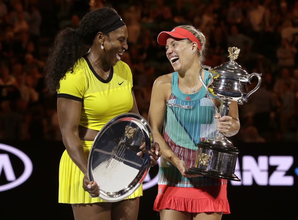 Angelique Kerber, right, of Germany enjoys a joke with runner-up Serena Williams of the United States after winning their women's singles final at the Australian Open tennis championships in Melbourne, Australia, Saturday.