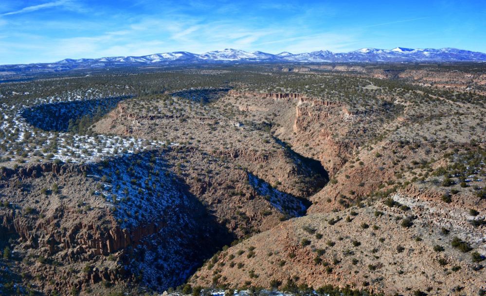 This Tuesday, Jan. 26, 2015 photo provided by Cynthia Meachum shows an areal view of the terrain where a search of treasure hunter Randy Bilyeu, went  missing along Rio Grande in northern New Mexico.