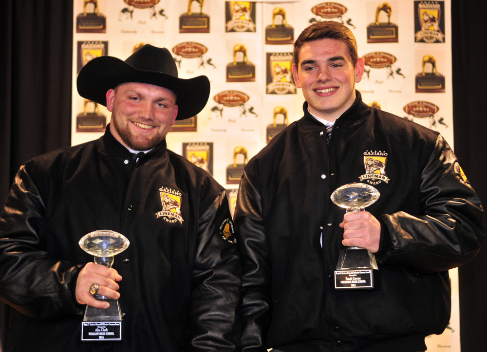 Alec Clark, of Winslow, left, and Frank Curran, of Cheverus, pose with their Frank J. Gaziano awards Saturday at the Augusta Civic Center.