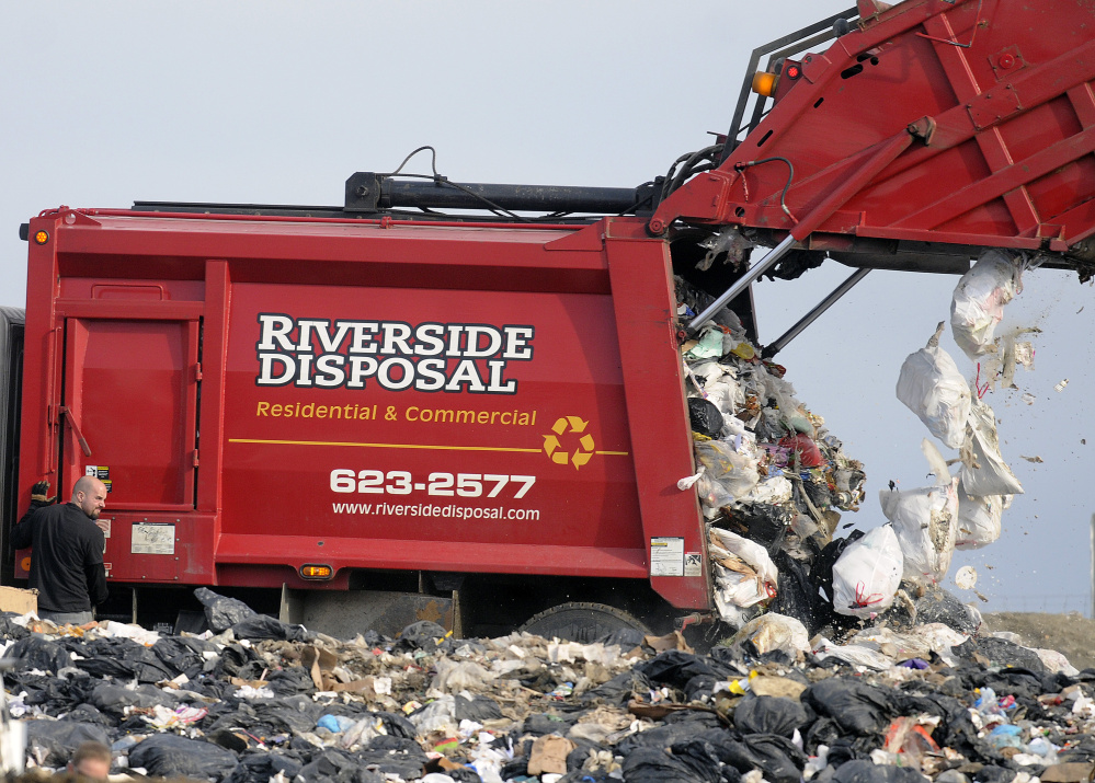 A Riverside Disposal truck dumps trash Tuesday at Hatch Hill Landfill in Augusta, where the City Council is considering a decrease in per capita fees for utilizing the facility.