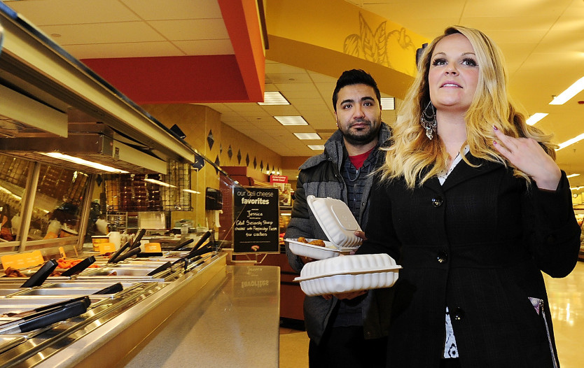 Heather Howell and Sadiq Majeed pick up hot wings for lunch in the takeout section of the Hannaford supermarket near Back Cove in Portland. Also available are sandwiches, quesadillas, hamburgers, pizza, burritos, sushi and salads.