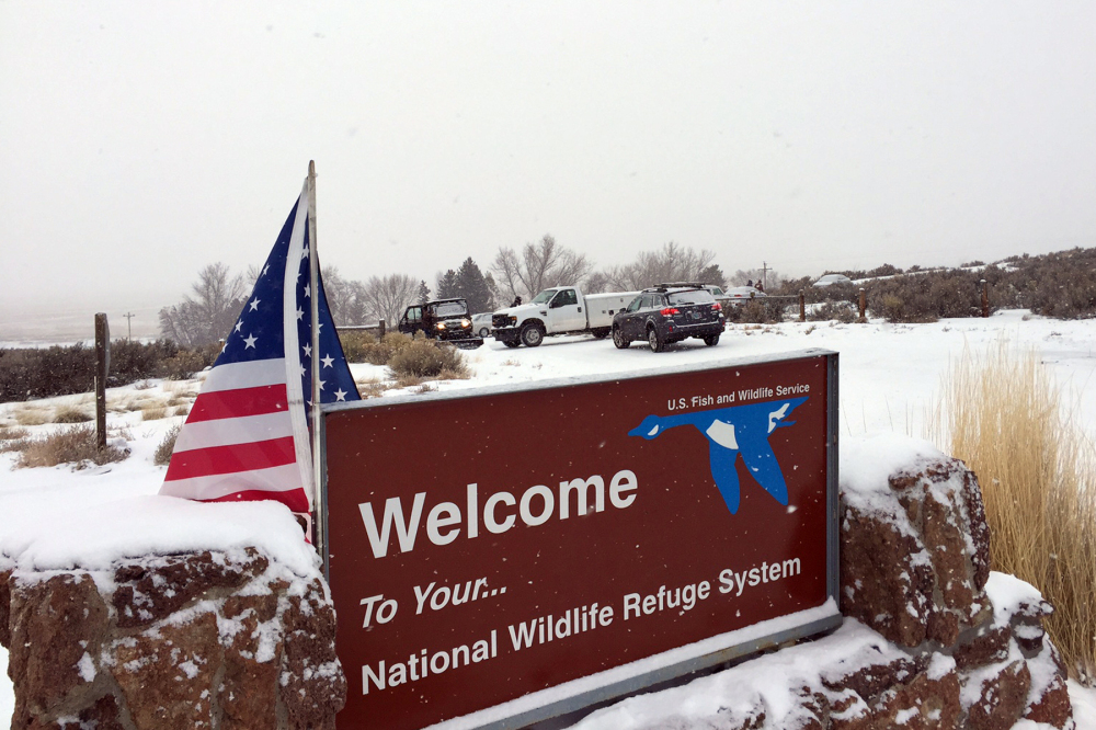 A sign marks the entrance to a national wildlife refuge about 30 miles southeast of Burns, Ore.