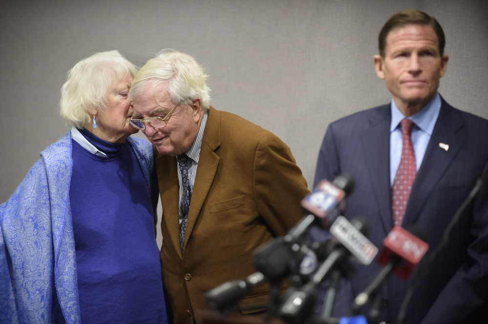 Ellen Kennedy whispers to her husband, Moorhead Kennedy, 85, who was one of 53 American hostages held 444 days at the U.S. Embassy in Iran from 1979 to 1981, during a news conference Monday in Hartford.
