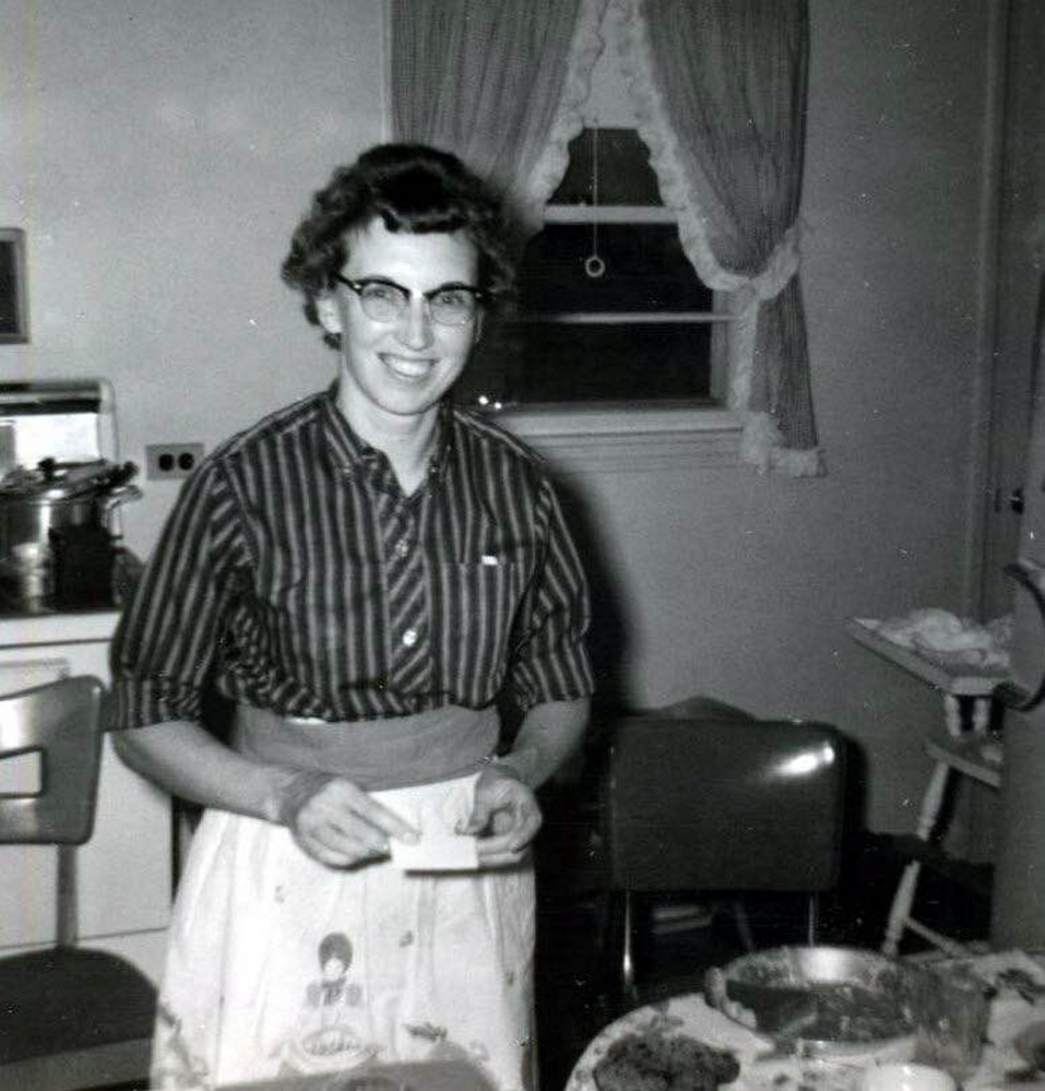 """Zoe Head Swift was """"an excellent baker ... who crafted eight pies for every Thanksgiving dinner – for more than 50 years."""" She is shown in her Portland home in the 1950s – and there's pie on the table."""