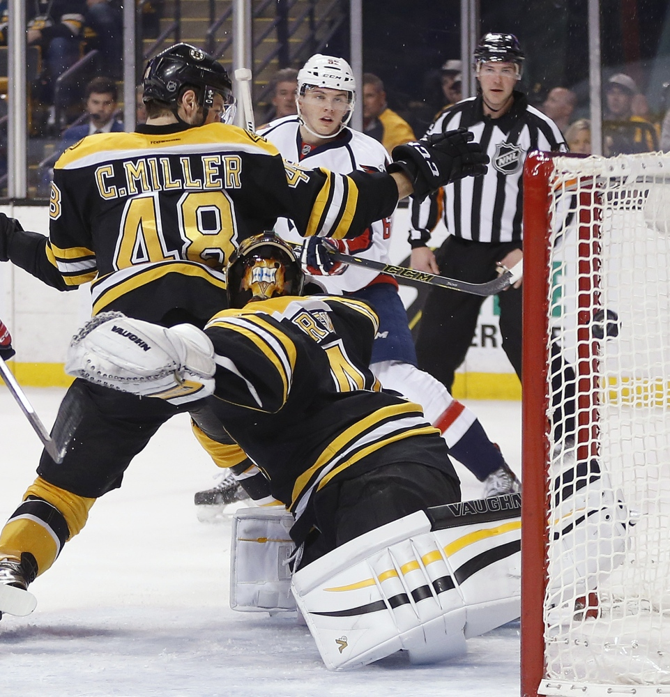 Washington's Andre Burakovsky, rear, scores on Bruins goalie Tuukka Rask in the first period.