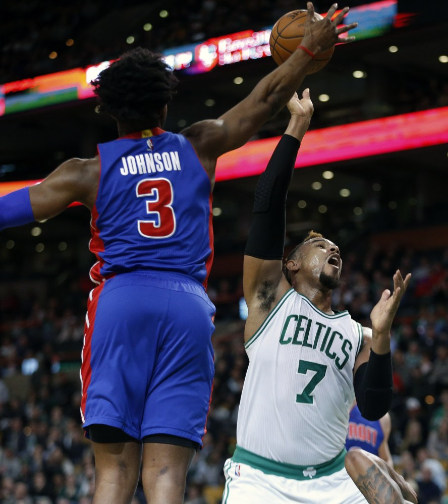 Detroit's Stanley Johnson blocks a shot by Jared Sullinger in the second quarter Wednesday night. The Celtics built a lead but let it slip away and lost, 99-94.