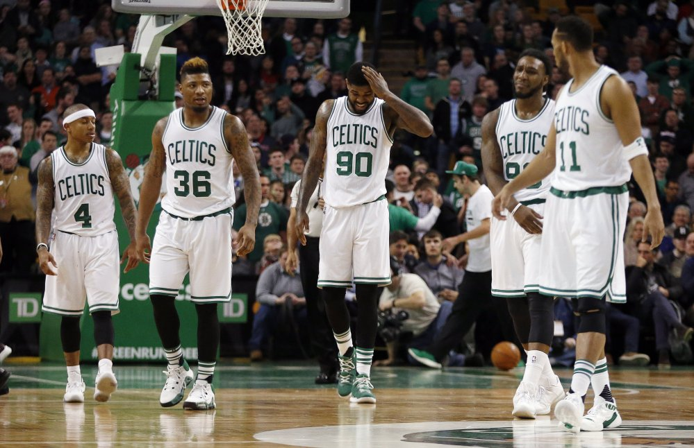 On the way to their third loss in the last four games, the Celtics walk to the bench during a timeout late in the fourth quarter of Wednesday night's home game against the Pistons.