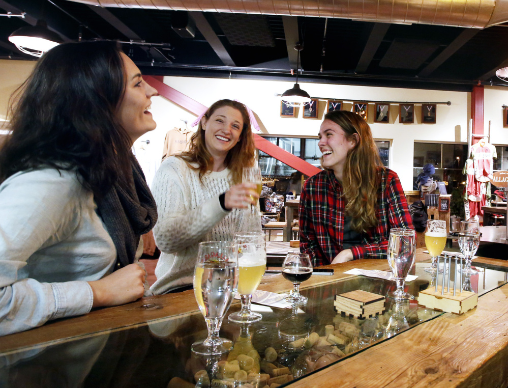 From left, Siena Mitman, Alessandra Piscina and Emily Powers sample the beer in Allagash Brewing Co.'s tasting room Wednesday. The company wants to sell prepackaged snacks to beer tasters, but that's prohibited under the city's zoning.
