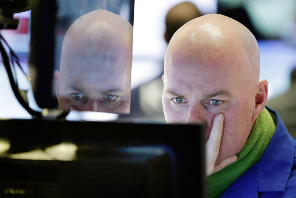 Specialist John O'Hara works at his post on the floor of the New York Stock Exchange on Thursday.