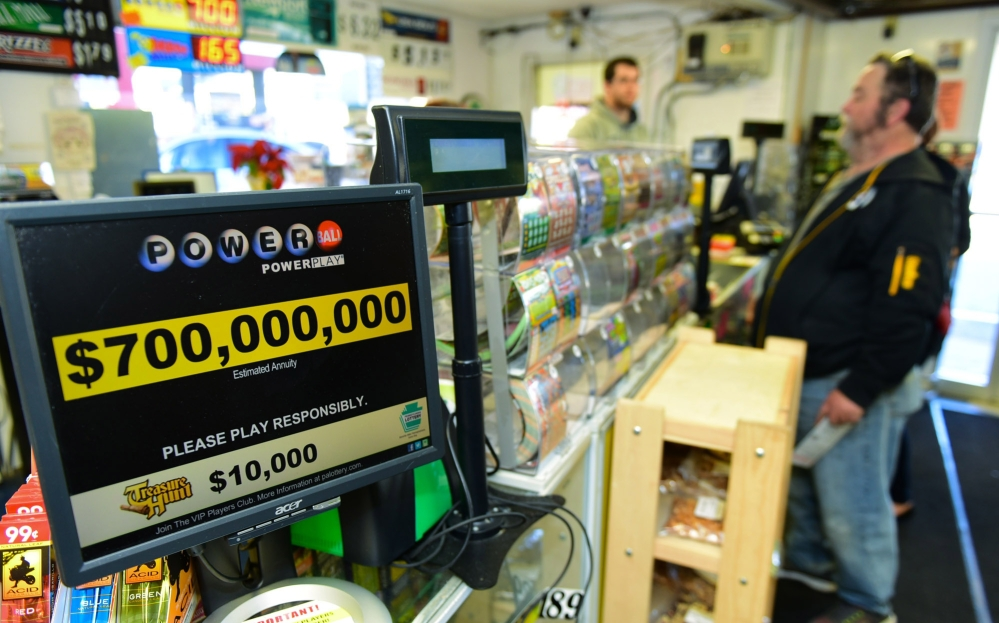 Jerry Clark buys Powerball lottery tickets Thursday at Bill's Kwik Chek in Chambersburg, Pa.
