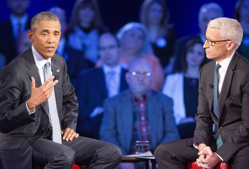 President Obama speaks about gun control during a televised CNN town hall meeting hosted by Anderson Cooper, right, at George Mason University in Fairfax, Va., on Thursday.