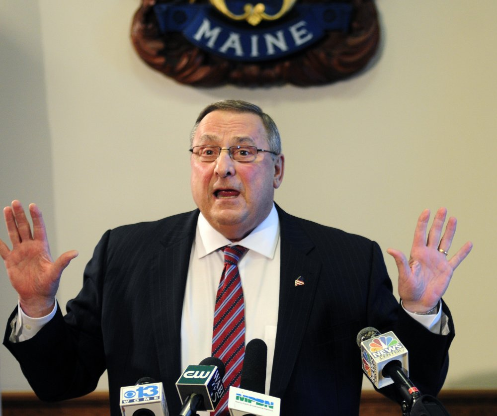 "Maine Gov. Paul LePage speaks Friday in the State House cabinet room in Augusta. He said he wasn't ""smart enough"" to deliberately tap old racial tensions about black men and white women, instead shifting the blame toward his critics and the media. (Joe Phelan/Kennebec Journal)"