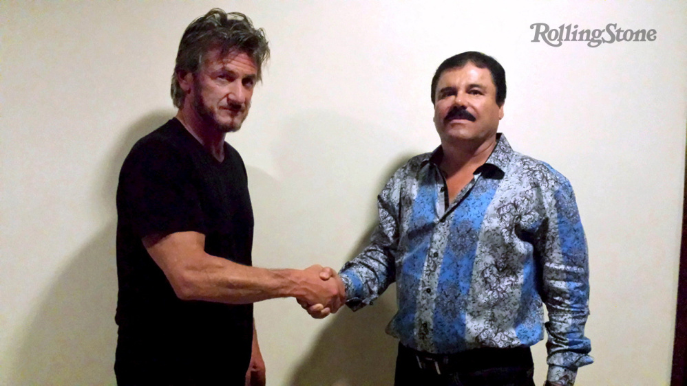 """Actor Sean Penn shakes hands with Mexican drug lord Joaquin """"Chapo"""" Guzman in Mexico, in this undated Rolling Stone handout photo obtained by Reuters on Sunday. The photo was taken for authentication purposes."""