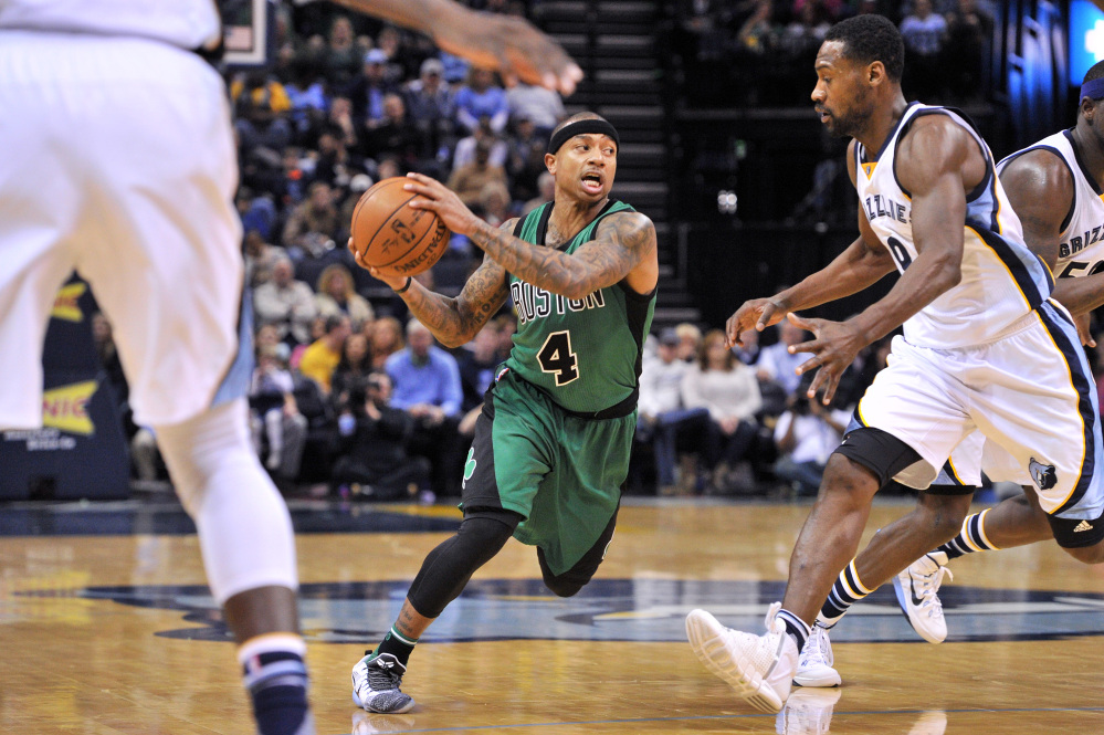Celtics guard Isaiah Thomas drives to the basket while being defended by Grizzlies guard Tony Allen during Boston's 101-98 loss Sunday in Memphis, Tenn.
