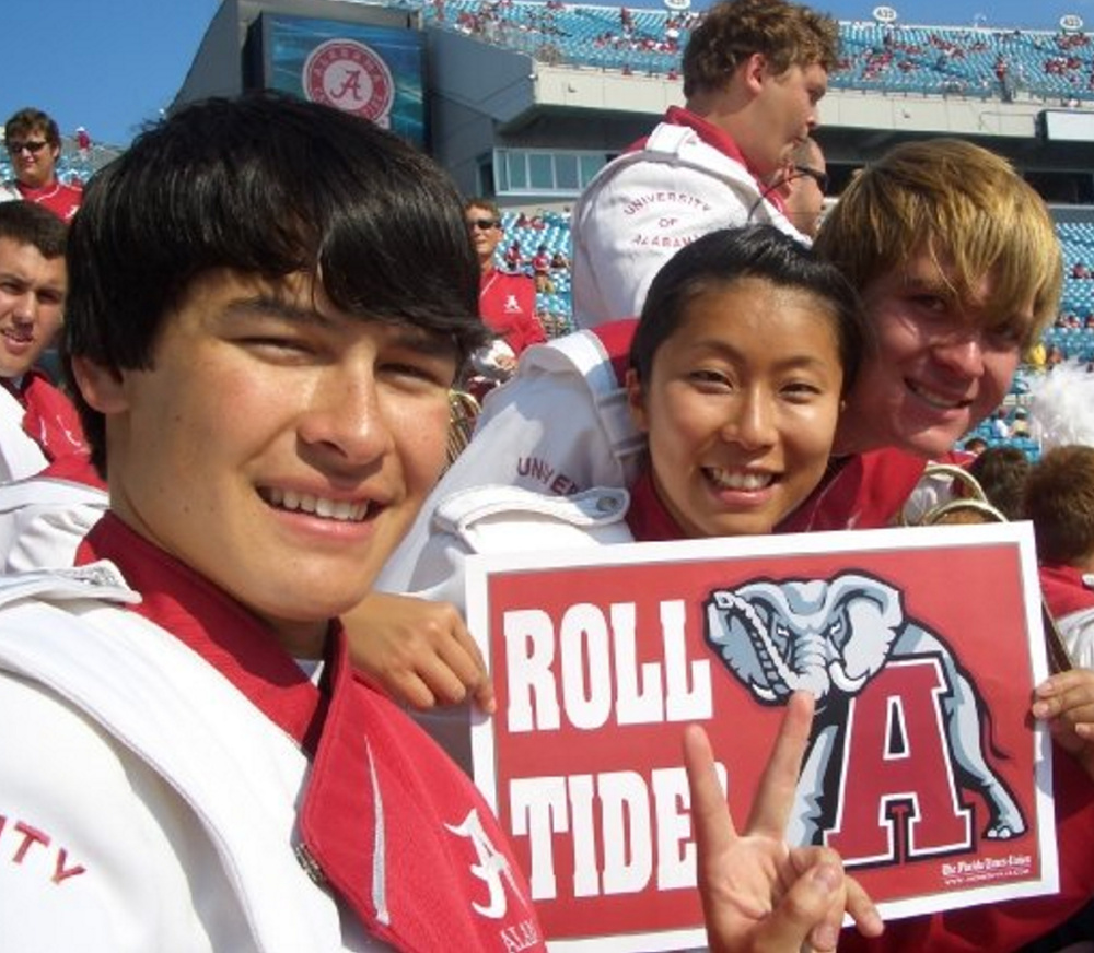 Norman Huynh, assistant conductor of the Portland Symphony Orchestra, graduated from Alabama and played in the school's marching band. Courtesy photo