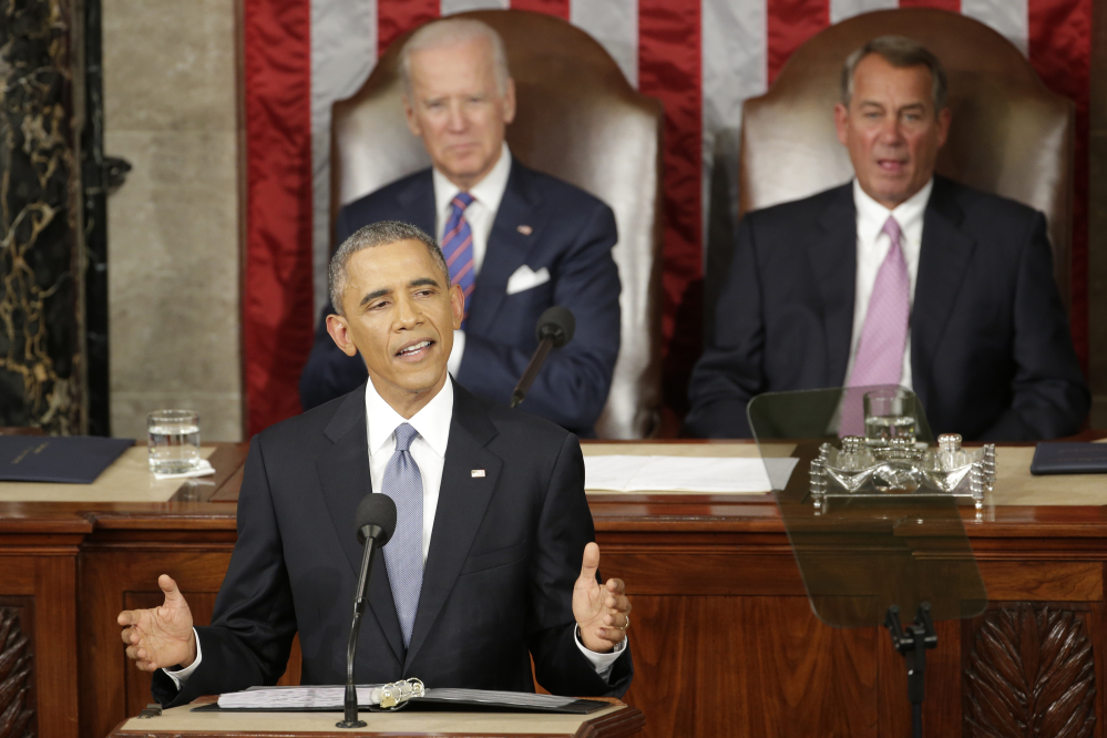In this Jan. 20, 2015 file photo, President Barack Obama gives his State of the Union address before a joint session of Congress on Capitol Hill in Washington as Vice Presient Joe Biden and House Speaker John Boehner of Ohio listen.