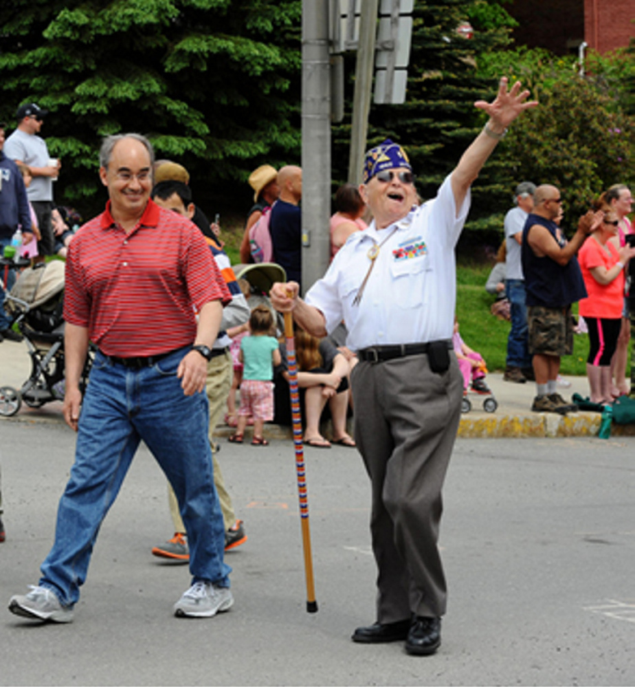 Rep. Bruce Poliquin walks alongside Norman Rossignol, a decorated Army veteran from Bangor who will be Poliquin's guest at the State of the Union address Tuesday.