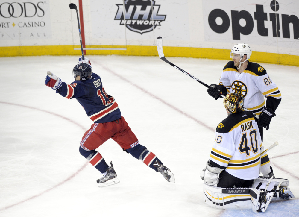 The Rangers' Jesper Fast celebrates his game-winning goal as Bruins Kevan Miller and goaltender Tuukka Rask look on with just 1:42 left in the third period. The Rangers defeated the Bruins, 2-1.