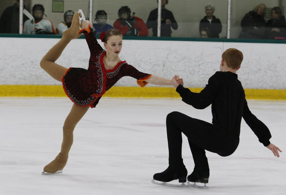 Julia Curran and Franz-Peter Jerosch perform their routine Monday night before a crowd of family and friends at the Family Ice Center in Falmouth. It was one of their final tune-ups before leaving for the U.S. Figure Skating Championships in Minnesota.