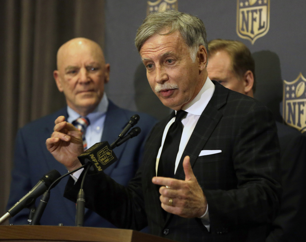 St. Louis Rams owner Stan Kroenke talks to the media after team owners voted Tuesday in Houston to allow the Rams to move to a new stadium just outside Los Angeles. The San Diego Chargers will have an option to share the facility. Houston Texans owner Bob McNair stands to Kroenke's left. (AP Photo/Pat Sullivan)